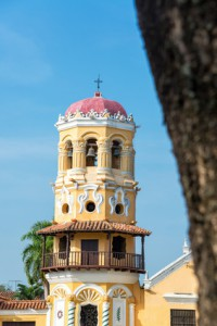 Yellow tower of Santa Barbara church in Mompox, Colombia